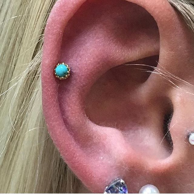 Fresh helix piercing done by @aarahmp at our Kennesaw location. He used a 16g @anatometalinc 18k yellow gold king end with a beautiful turquoise stone. Visit Planet Ink Kennesaw to check out our other unique jewelry pieces!  #piercing #helixpiercing #turquoise #jewelry #earadornments #anatometalinc #planetinktattoos