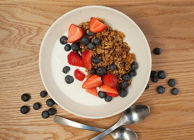 House-made Granola. Gluten free oats, honey, olive oil with yogurt and berries. Start the morning off right!