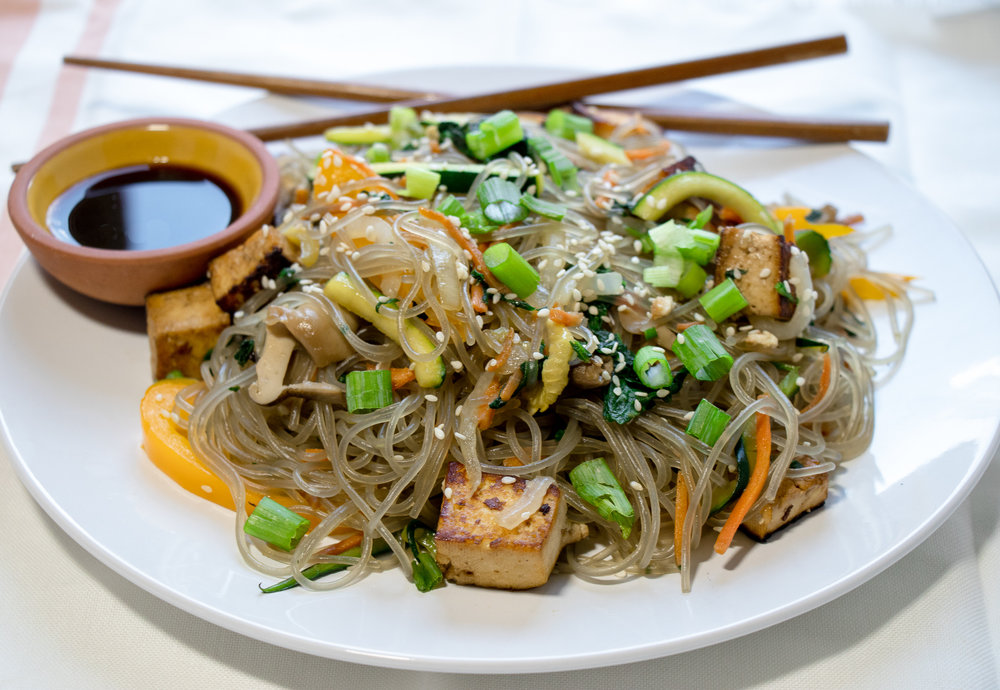 Japchae is a savory Korean noodle dish, made with sweet potato starch noodles. You can easily find these noodles at your local Asian market or online. This dish is pretty quick, and easy, making it a great week night dinner!