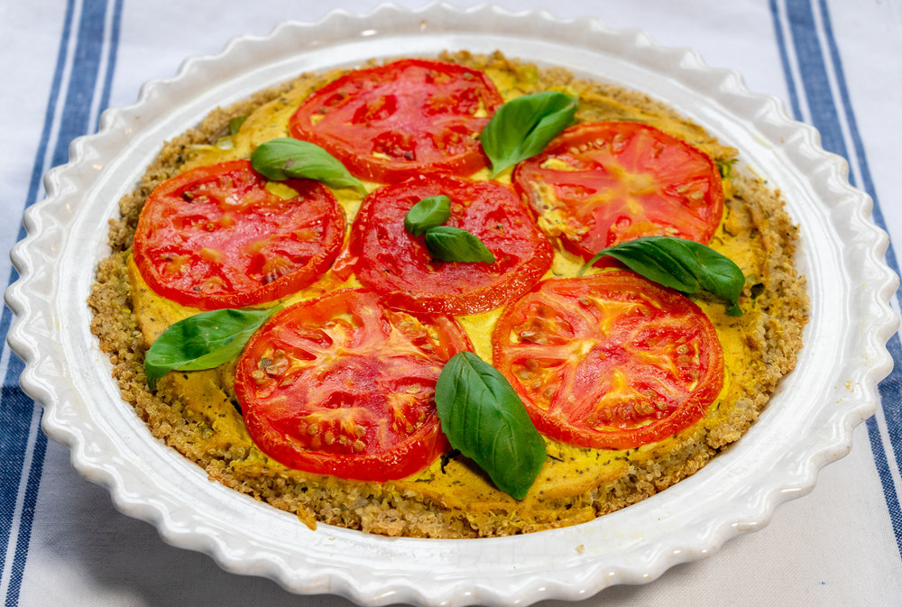 This delicious and beautiful breakfast pie, combines layers of tofu quiche, with roasted tomatoes, and potatoes, all nestled in savory quinoa crust.