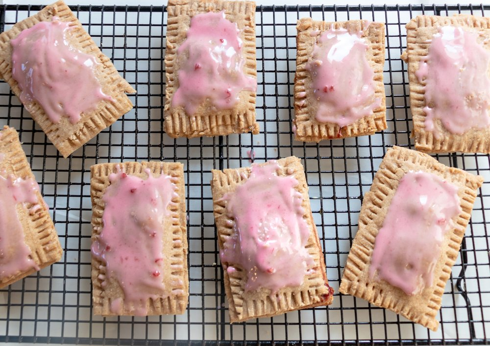 I LOVE pop tarts! Love them. Over the years I have tried several variations of dough and filling. I settled on this dough because the little bit of extra butter gives them a nice flakey crust, somewhere between a pop tart, and a toaster strudel. If you don't like strawberries then I'm baffled, but its your pop tart, so fill it with any flavor jam you like.  You can fill them with nut butter, maple butter, sweet vegan cream cheese....anything you want!