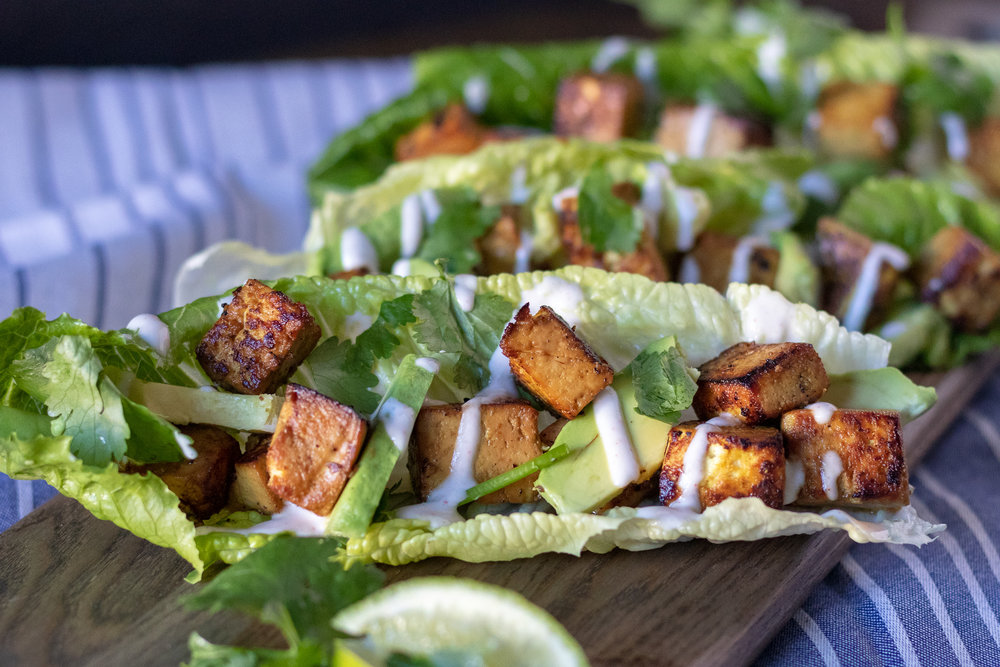 Easy weeknight dinners are a must in our busy house, so I always make sure to have some extra firm tofu in my fridge for quick dinners like these cilantro avocado tofu wraps. The marinated tofu, creamy avocado, crispy lettuce, and tangy sauce make for a perfectly delicious, healthy filing meal! These gluten free  wraps are packed with plant protein ,and healthy fats to keep you full and fueled!