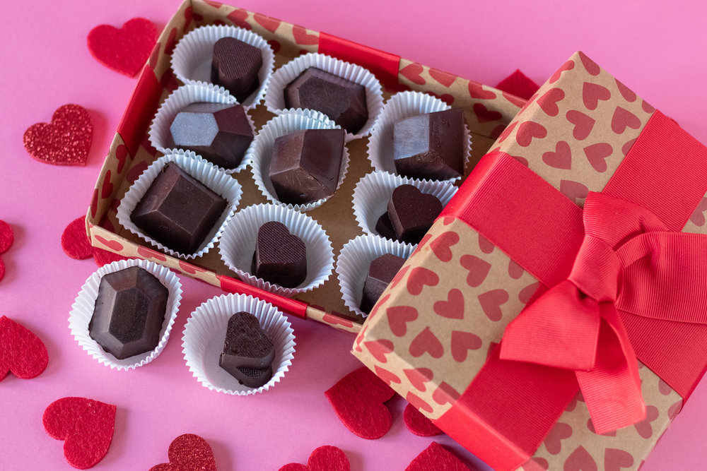 I am pretty sure in my lifetime I have eaten more heart shaped boxes of chocolates than I care to share with you. I LOVE cream filled, caramel filled, nugget filled, nut filled, jelly filled, chocolates. Seriously, my husband will attest to this fact, and he will also tell you I am the kind of person who will take one bite out of each one, like a jerk, so that they are from the point on property of ME, and so no one else will want them (I'm not proud of this, but it is what it is.) You know what I am talking about. You take a little bite out of one and realize its not your fave and move on, but once all the good ones are gone you will go back to those less tasty chocolates, out of desperation. But, what if you made your own chocolates full of your most favorite flavors, AND they were vegan! Well my friends it's actually really simple! You just need a candy mold, some vegan chocolate, and a few things for the fillings. I wish I could take full credit for these sweet little master pieces, but it is actually our 13 year old, genius of a baker daughter ,Peyton, who brought us to this magical place of homemade chocolates! I will however take full credit for eating more of these candies than anyone else in our house. So this Valentine's Day (or any ol random day) whip up a batch of these for someone you love, like, simply tolerate, or even for yourself. And if you don't want to make them yourself, get one of your kids to do it while you watch reruns of the Office with your feet up, sipping on some coffee (I'm just daydreaming at this point) xoxo
