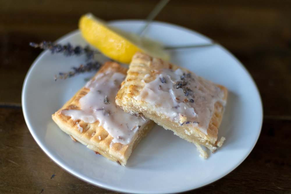 I never grow tired of making pop-tarts. I also never grown tired of thinking of new flavors to fill them with! I love all things lemon lavender and these pop-tarts are no exception . Filled with an easy, tangy sweet  lemon curd , and cream cheese, and topped with a sweet lemon lavender glaze, these pop-tarts are hands down my favorite flavor! This pie dough is super quick and simple, as is the recipe for the  curd!  If you have never had lavender in a baked good, especially paired with lemon, I think you will love it! If you don't, then I am terribly sorry and honestly confused, because it is delicious! Look for dried culinary lavender In your grocery stores bulk spice section. If you do not have luck finding it in larger grocery stores, look at you local health food market or farmers market.