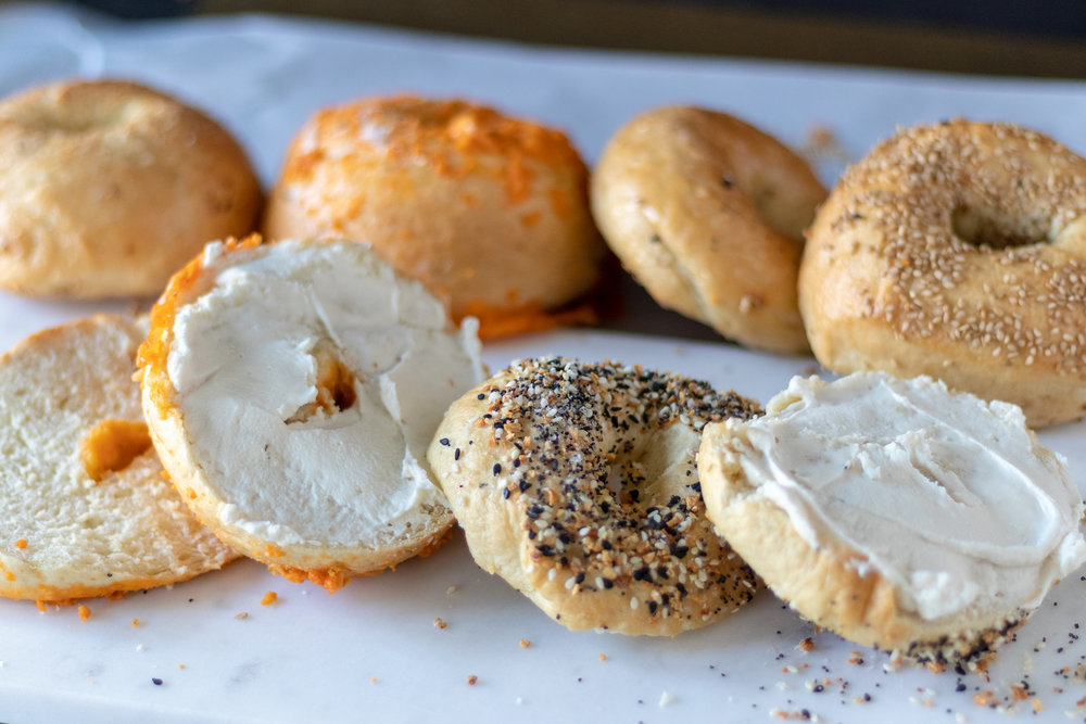 Warm, chewy on the outside, soft on the inside, fresh, homemade bagels! Yes, Yes, and YES! Seriously, y'all, fresh homemade bagels are so easy to make, plus you get to top them with whatever you want! Bagels freeze really well, so make yourself a double batch on the weekend, and next week's breakfast just got a lot easier, and a whole lot more tasty! If you don't believe me, I have left photo proof of our two year old digging into a fresh everything bagel that she slyly snatched as we were trying to photograph them. I mean she just did the thing the rest of us wanted to do. But who can blame her. They are that good! And if y'all can't do gluten, don't worry! Our friends over at Not  That Kind of Vegan  took this recipe and turned it gluten free, so go check out their  recipe  !! Now everyone can have their bagel and eat it too!!