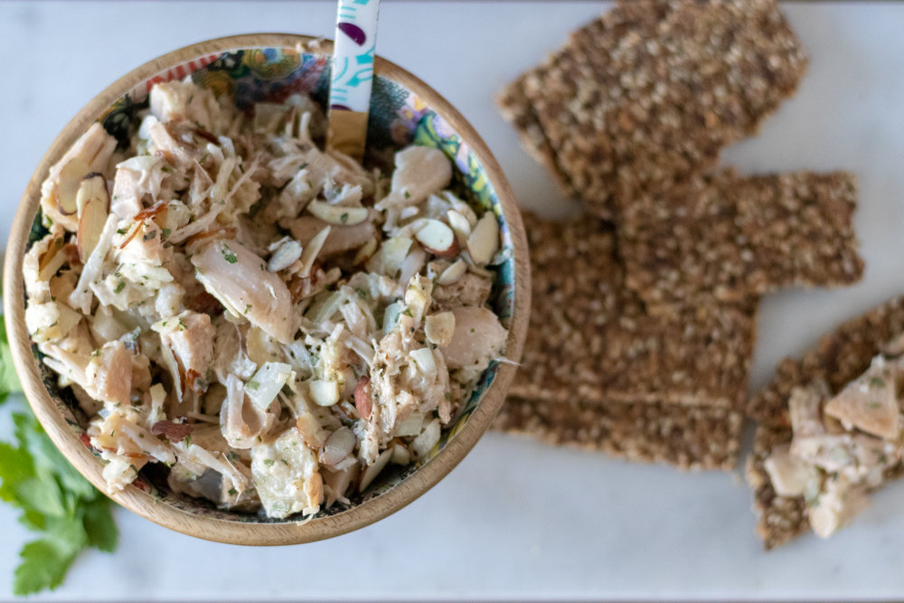 "Jackfruit is an easy and popular substitute for shredded meat. It works especially well as a chicken salad substitute, and is perfect for this tarragon and almond ""chicken"" salad recipe. This jackfruit salad is savory, creamy, and has just the right amount of crunch from the onion and almonds. I love it on crackers, or on top of a nice green salad, but it also makes a pretty tasty sandwich! It also works well as a party appetizer severed with fresh cut veggies,  vegan coconut milk gouda  and crackers."