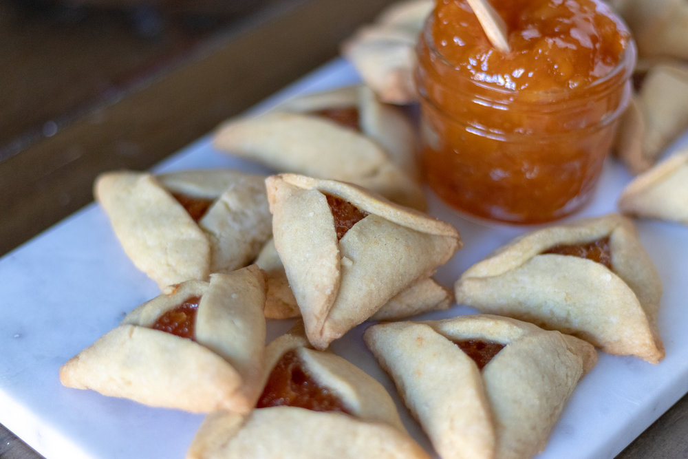 Hamantaschen cookies are typically baked durning the Jewish holiday, Purim. These tasty little bites can be filled with an array of fillings,  savory  or sweet, but often are filled with  apricot jam . Our  apricot jam  recipe is so easy and the perfect filling for these classic vegan hamantaschen. Also, you don't have to celebrate Purim to enjoy these cookies. These tasty, sweet treats can be enjoyed any time of year! And if you are not a fan of apricot jam, use your imagination and fill them with anything you like from jam, to chocolate, to  vegan cheese !