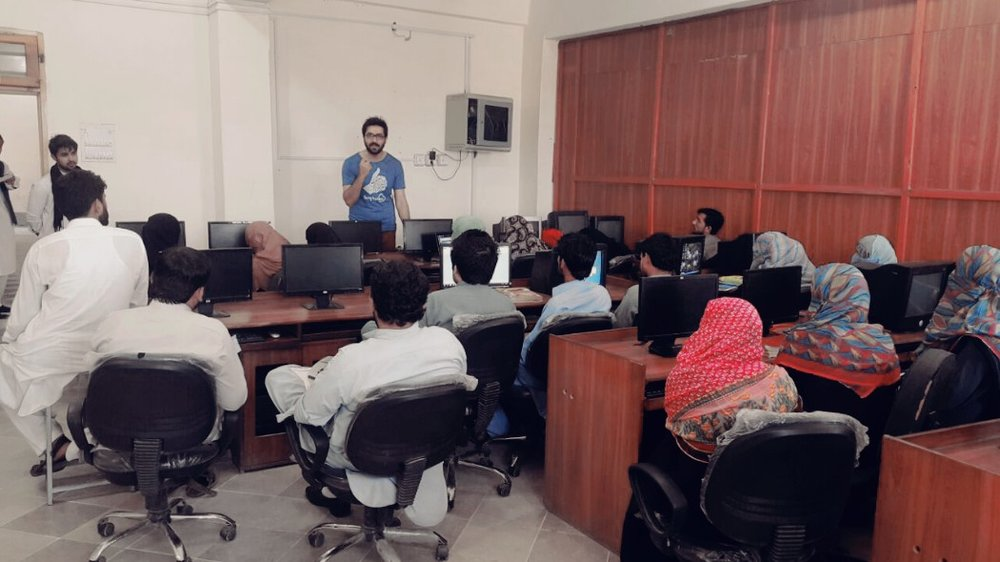 Shaikh Obaidullah - Deputy Director SSBC, giving an orientation session to the students at University of Sciences and Technology, Bannu
