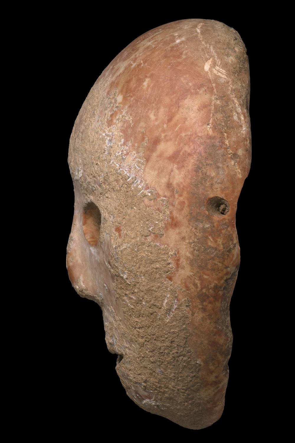 Profile view of the Ancient Mask.  Photo:  Clara Amit, Israel Antiquities Authority