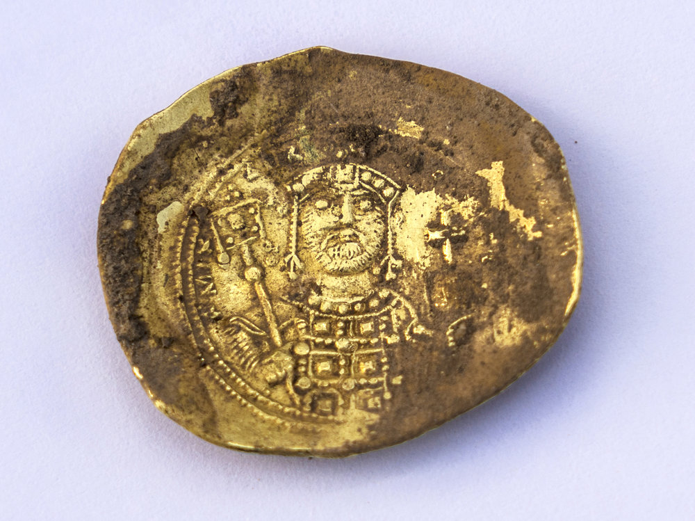 "Convex-shaped gold coin ""nomisma histamenon"" of the Byzantine emperor Michael VII Doukas (1071 – 1079 CE).  Photo: Yaniv Berman,  courtesy of the Caesarea Development Corporation"