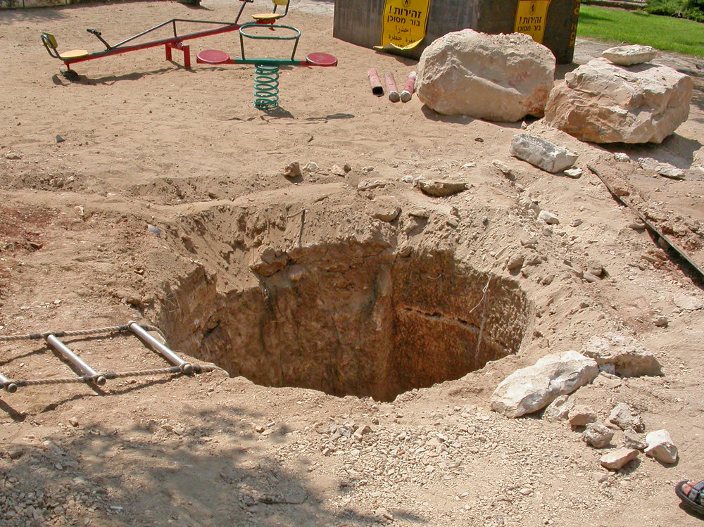 Entering the cistern in 2005.  Photo:  Ofer Cohen, courtesy of Israel Antiquities Authority