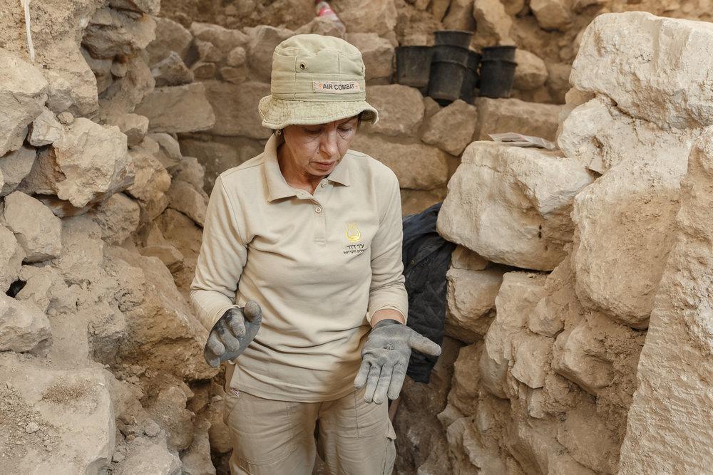 Sveta Pnik working at the site where the bulla was found in the City of David.  Photo:  Eliyahu Yanai, City of David