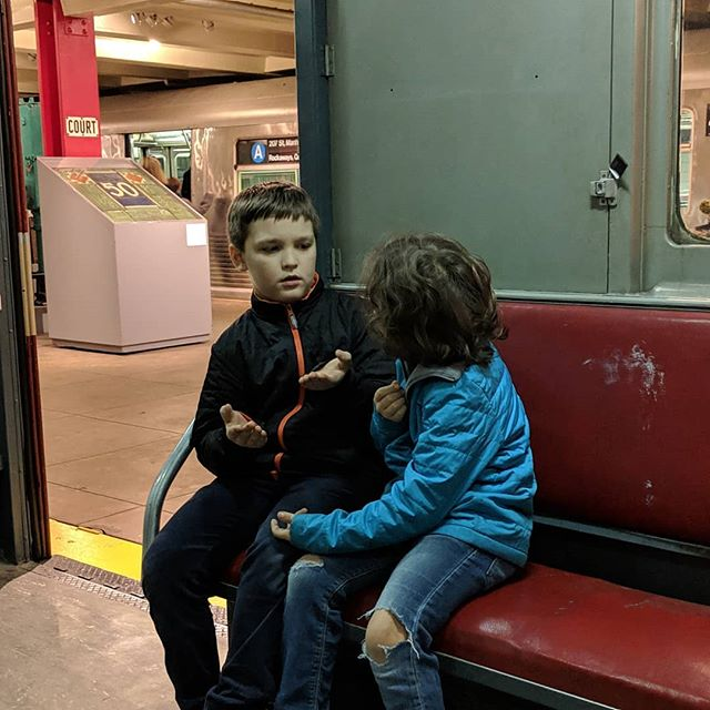 One of my favorite photos from this weekend's trip to the @nytransitmuseum. They are pretending to have a discussion while commuting to work. Truly, a child's imagination is a wonderful thing.  No one talks on the subway.