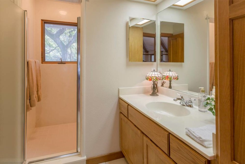 Private bathroom adjacent to the Rejuvenate room equipped with a walk-in shower.