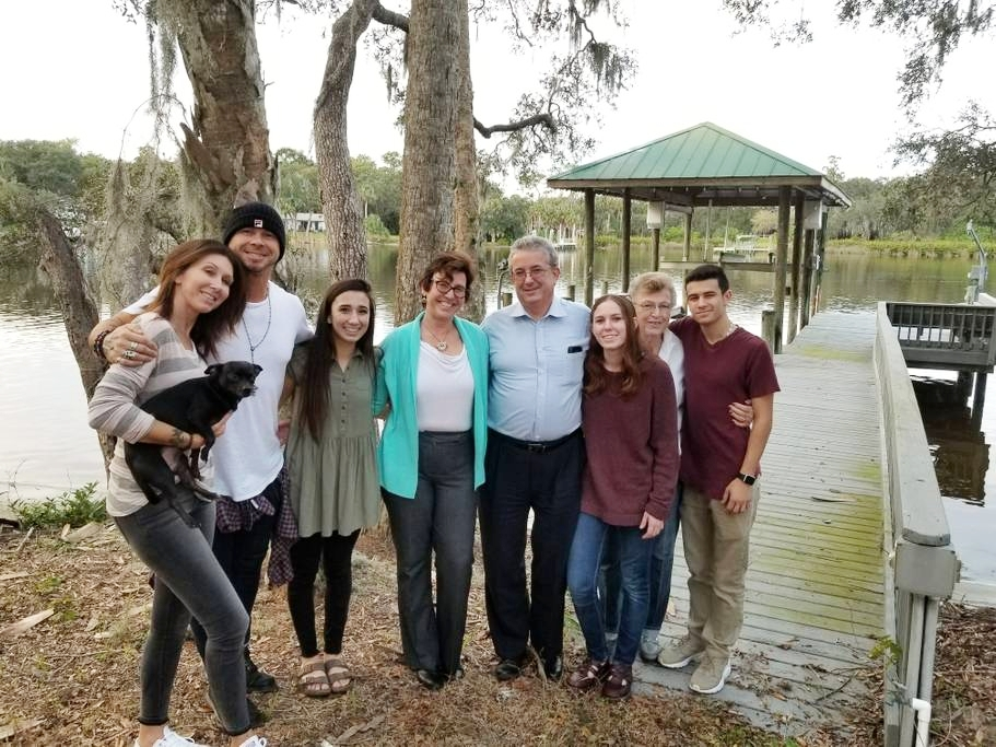 My husband and I with some of our family at the dock right before purchasing the home