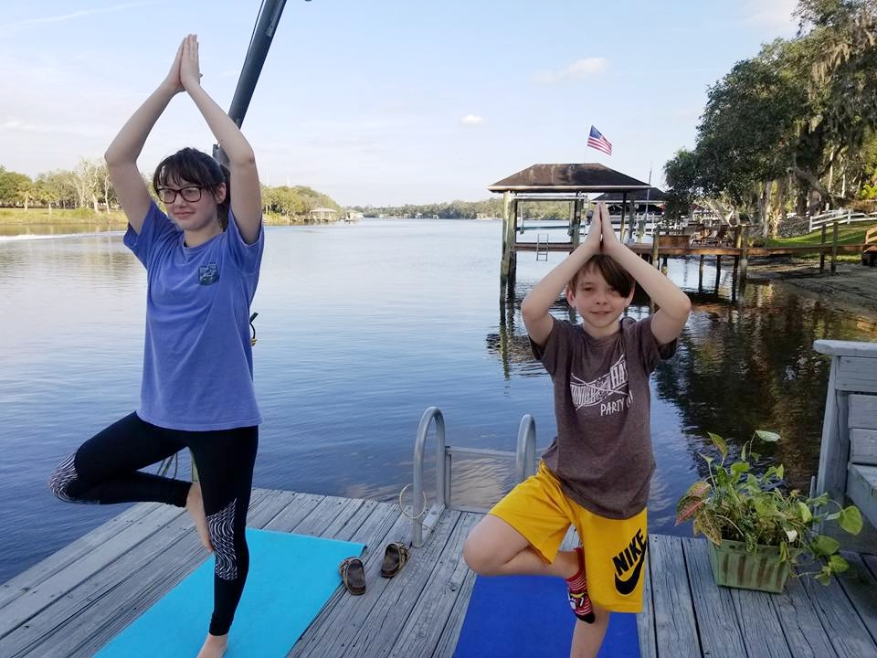 Two of my grandchildren doing stretching on the dock