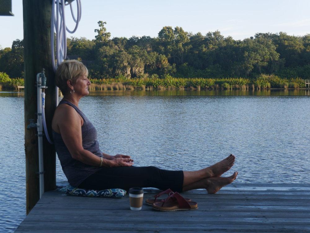 meditating-by-river.jpeg