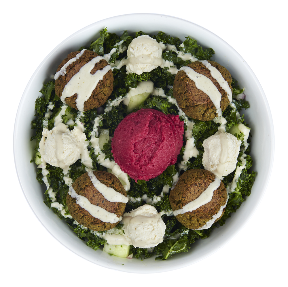 Mediterranean Falafel Bowl  - $11.99  Kale, cucumbers, red onions, beetroot hummus, baked quinoa falafel, almond cheese, cashew sauce