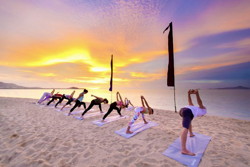 Sunset yoga in Koh Samui. Photo from W Hotels website  here .