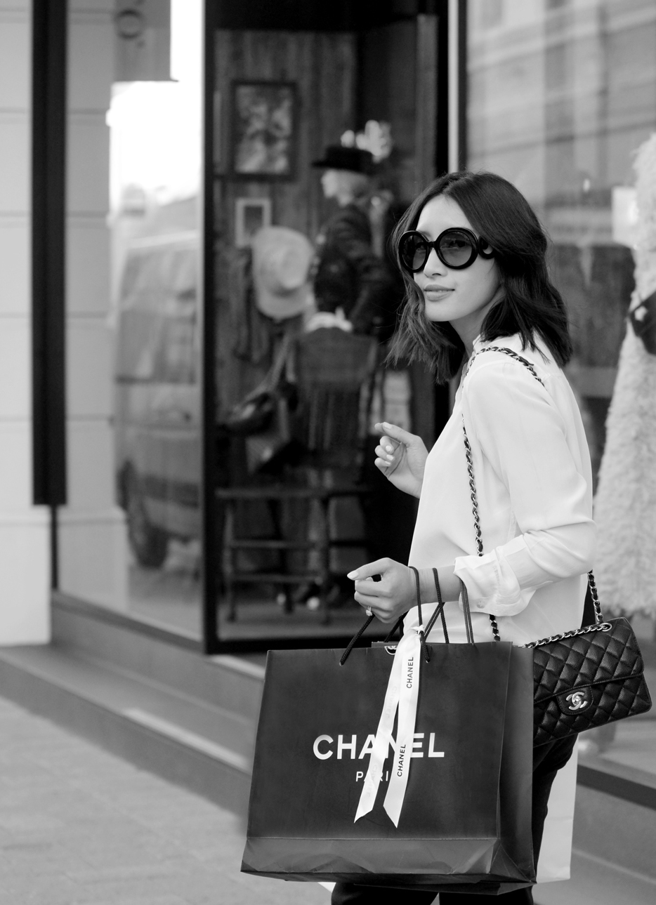 A customer walking out of 39 King Street Perth with her new CHANEL handbag