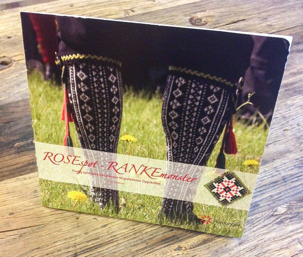 """Historikk og oppskrift er å finna i mønsterheftet     """"ROSEspøt - RANKEmønster""""    ."""