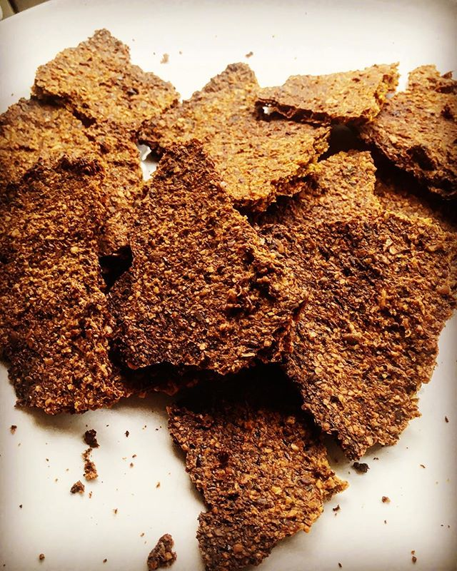 Playing around in the kitchen today and creating keto crackers made from flax meal and seeds. These are so simple to make and perfect as a carb alternative.  Simply choose a seed that becomes gelatinous when hydrated, add seasoning and enough water to make thick paste, leave covered in fridge for 12hrs, spread on parchment paper thick enough to form a cracker, spread evenly and bake at 160c for 1hr.  You could try using sesame or chia as another option. I recommend grinding flax seed into a meal as we don't break these down in the gut, this way the nutrients are more bio available.  These are garam masala and turmeric flavour perfect for Kapha's, for Vata's you could spread some gorgeous ghee on them and Pitta's you could flavour with fennel instead of garam masala and dip into a cucumber raita #flaxseed #ketocrackers #ketodiet #ketosis #ayurveda #dosha #omega #healthyfats #efa