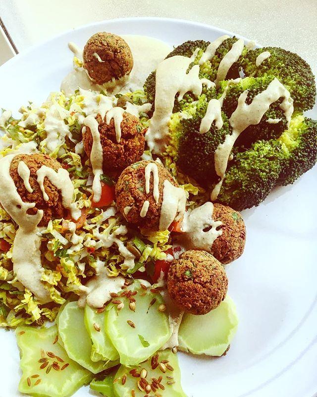 Enjoying homemade baked falafels with mixed greens and black tahini dressing #eatyourgreens #frugalliving #foodie #falafel #tahinidressing #kaphaseason #livegreeneatgreen #healthyfood #ayurveda #ayurvedacooking #ayurvedalifestyle