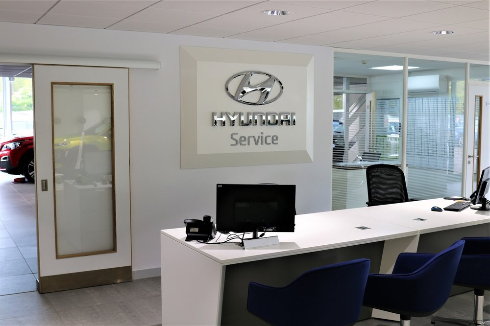 Hyundai service reception desk to match branding