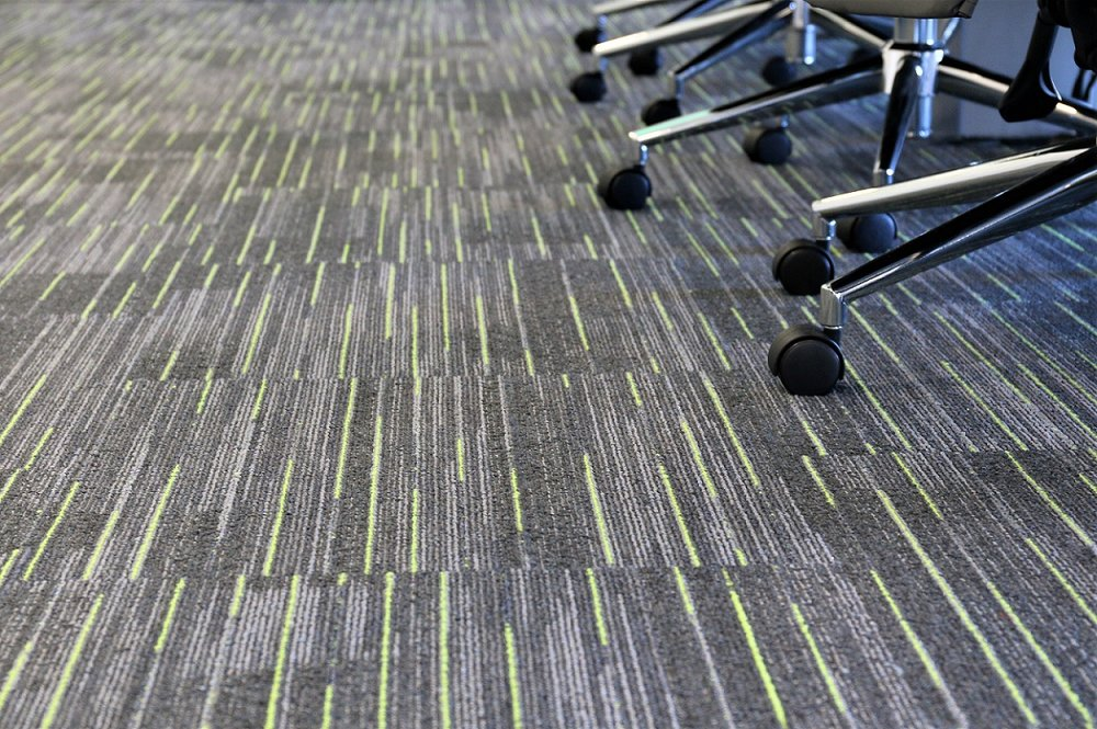 Flooring to match corporate branding in boardroom
