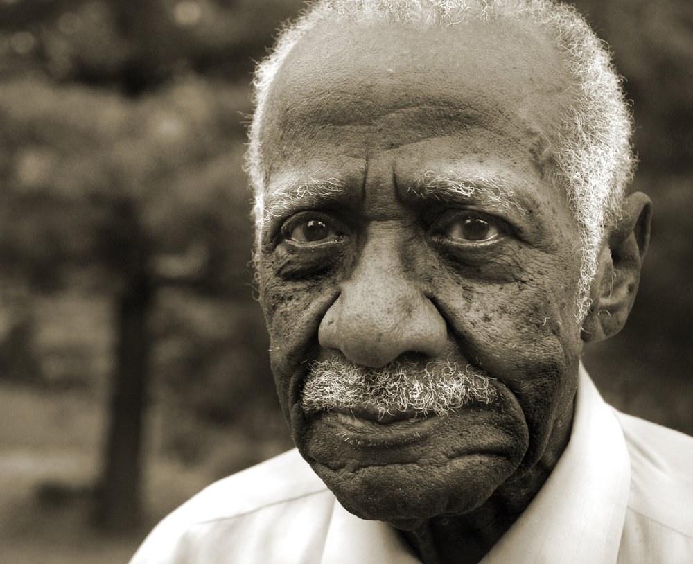 "Broomsy Salter (pictured at 94 years old) became the first African-American in Freeport, Illinois to move across the ""color line"" in 1956, when he bought land from a Jewish man and built a house. Until 1966, African-Americans were restricted to buying, renting, and leasing east of Illinois 26. The east side of Freeport has a flood plain."