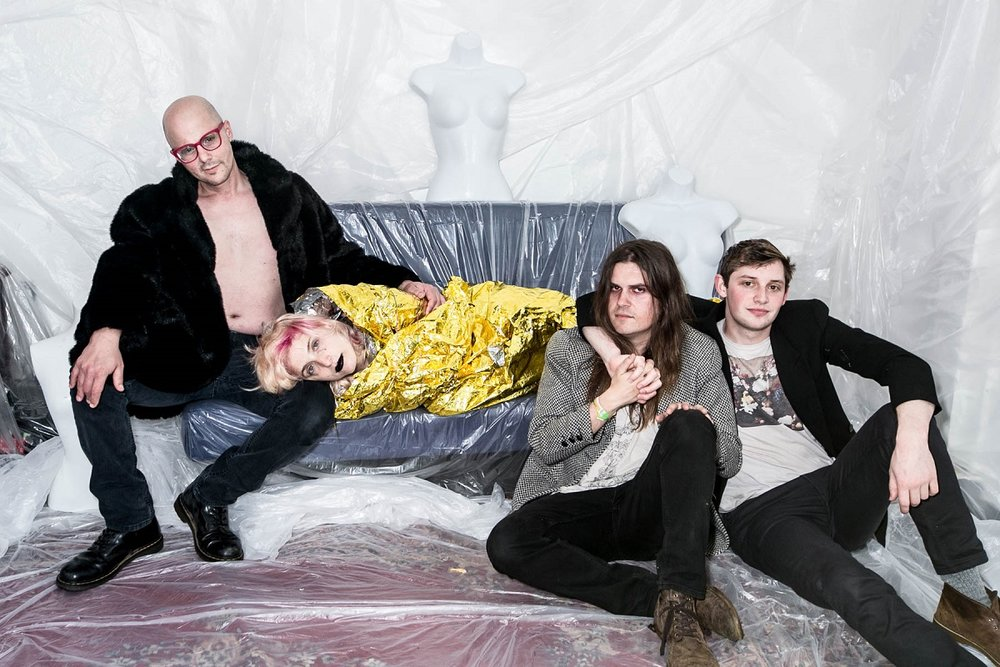 From left—Everyone is Dirty's Christopher Reece Daddio, Tyler English, Sivan Lioncub and Jake Kopulsky—wrapped in plastic by Jazmine Schwinges-Williams at Oakland's The Bad Seed; photographed by Ginger Fierstein.