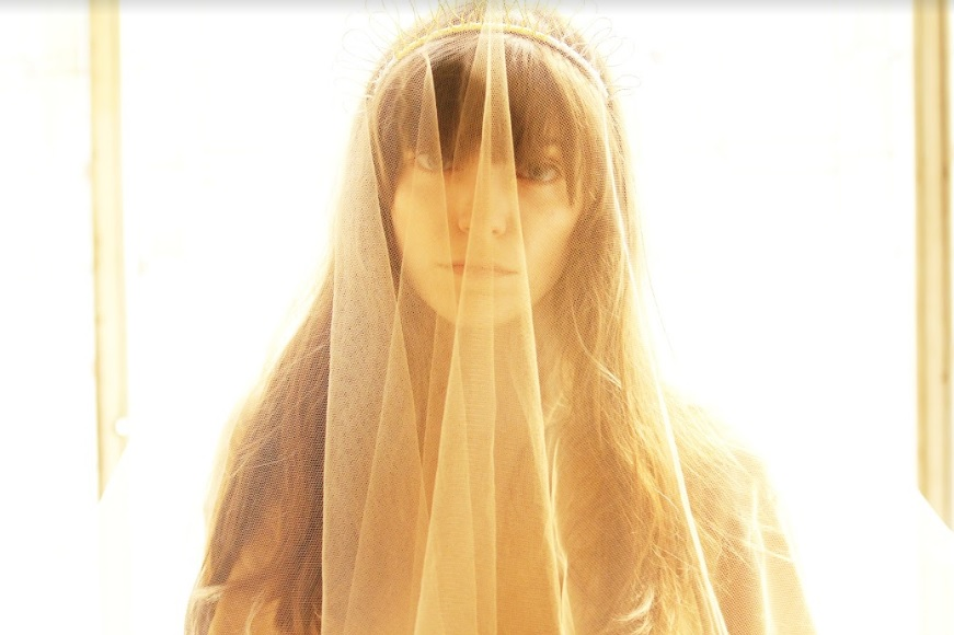"""Beyond the veil with Sarah P.; photo still from """"Lotus Eaters"""" video courtesy of George Geranios."""