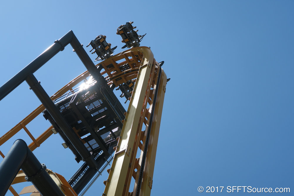 A car reaches the top of the lift hill.