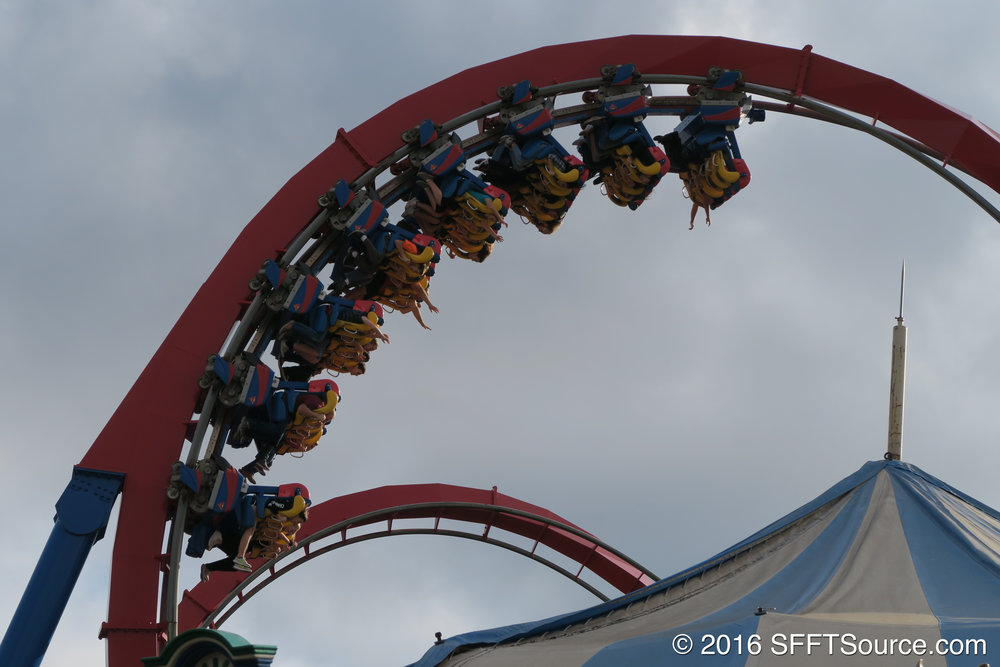 A train propelling through the cobra roll.