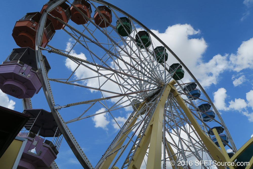 The ride is an old-fashioned ferris wheel.
