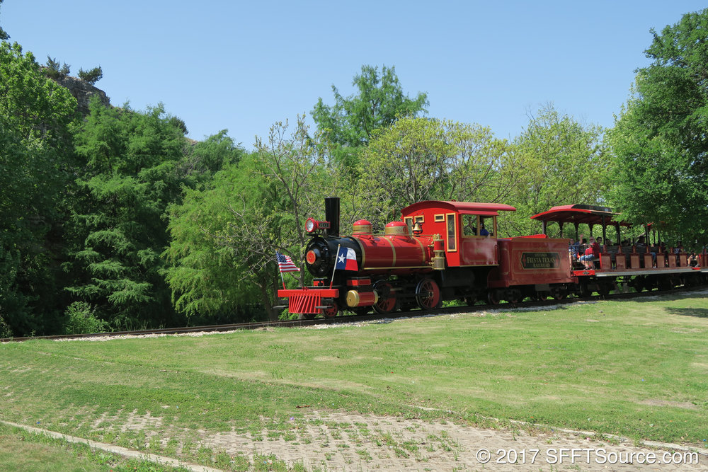 The Fiesta Texas Railroad leaving Whistle Stop.