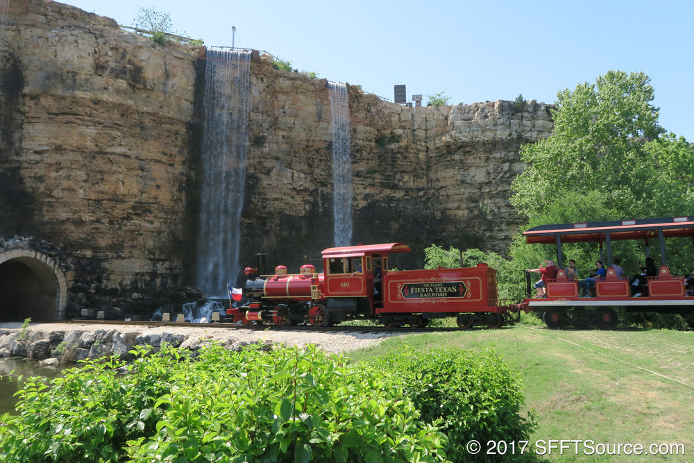 The Fiesta Texas Railroad entering the quarry wall tunnel.