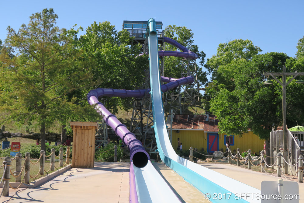 Guests ride in a fully-enclosed slide.