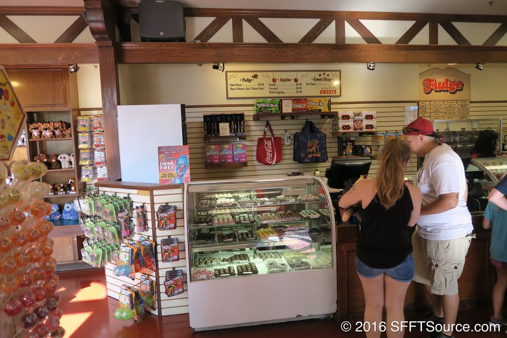 The shop sells fudge, caramel apples, candy, and more.