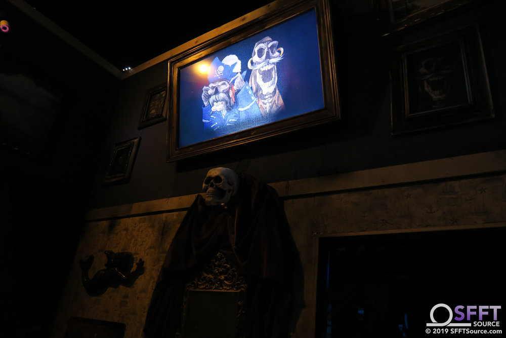 The inside queue of Pirates of the Deep sea is an immersive pirate village with many special effects.