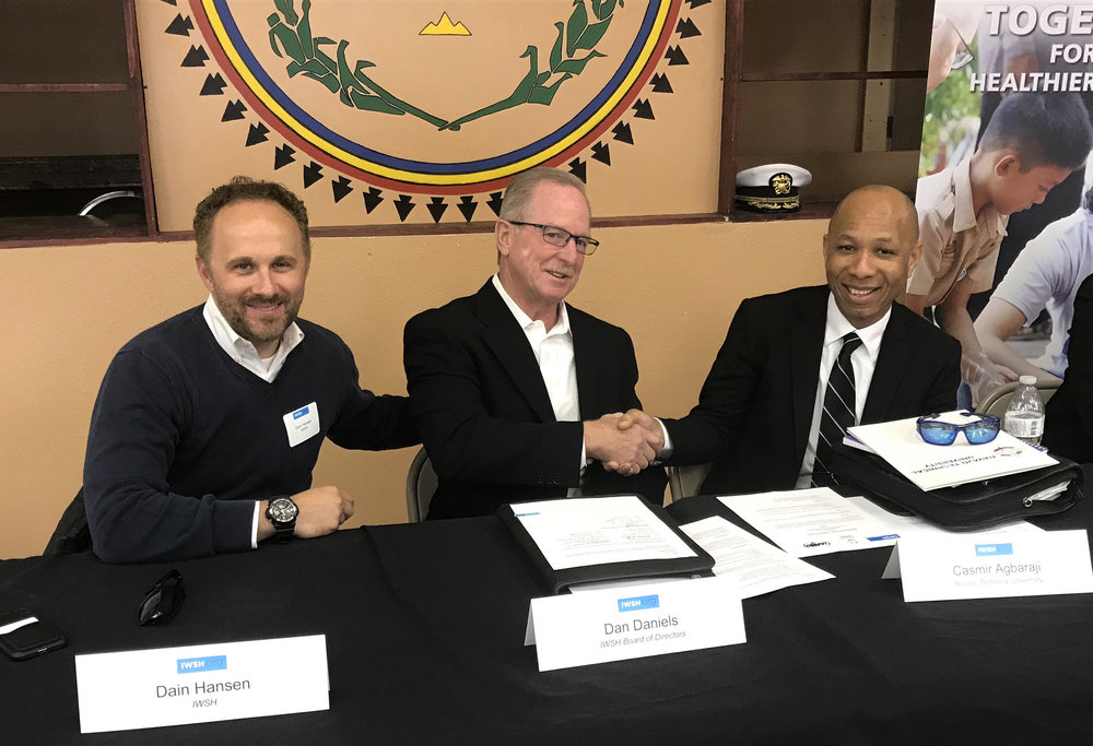 Left to right: IWSH representatives Dain Hansen (Managing Director) and Dan Daniels (Chair, Board of Directors) meet with Casmir Agbaraji (Dean, Navajo Technical University) to sign a Memorandum Of Understanding marking the launch of Community Plumbing Challenge, Navajo Nation.