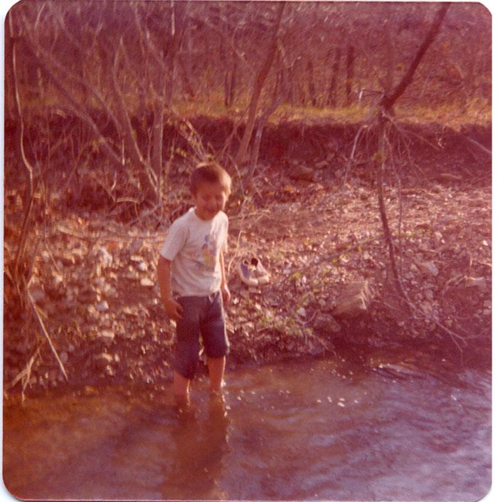 small_John---1977-April---Rancho-del-Valle---Hartville-Missouri---Taking-Bath-in-Creek---600-dpi.jpg