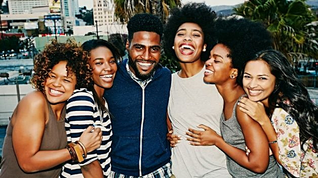 061014-national-friends-group-man-women-laughing-smiling-happy.jpg