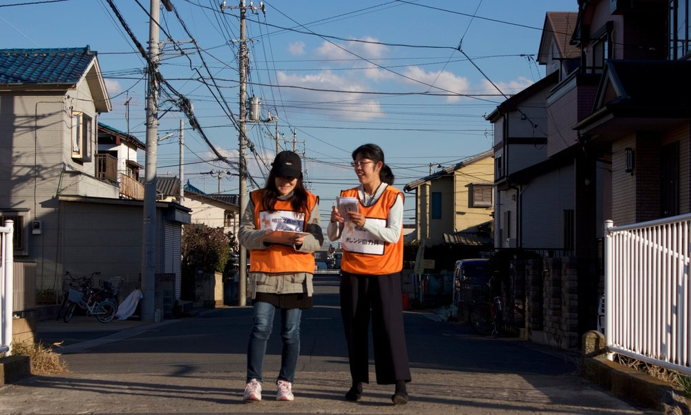 Orange Plan welfare volunteers. Photo by Justin McCurry for The Guardian