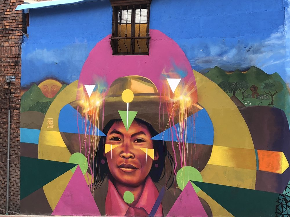 """The local artist Guache honors the ancestral people of Colombia through his art. In the ancient language spoken by the local Chibcha people, Guache was the word for """"warrior."""""""