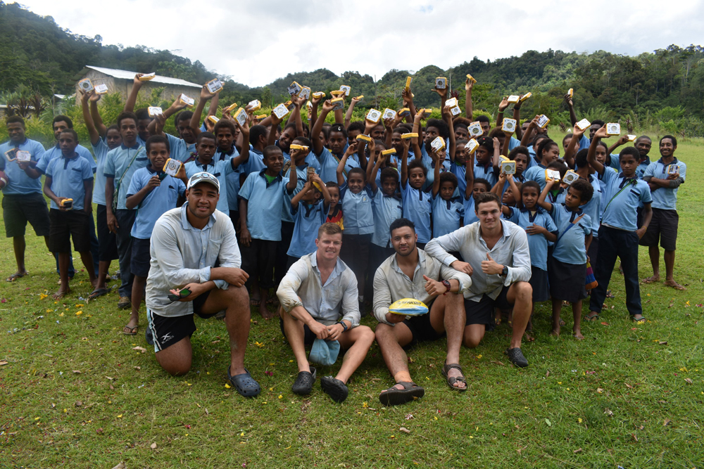 The Sharks with students at Manari Community School in PNG.