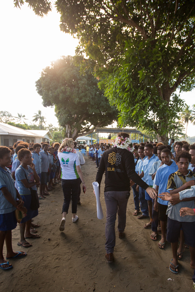 Students in PNG creating a guard of honour for SolarBuddy and KTF's CEO's Simon Doble and Gen Nelson.