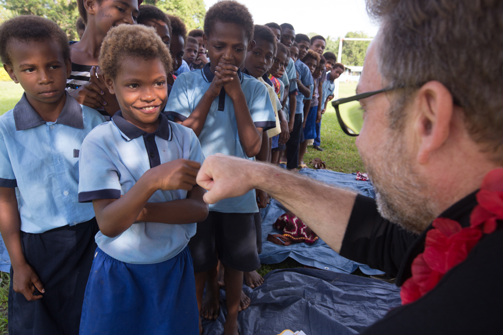 Fist pumps with the CEO, Simon Doble in PNG.