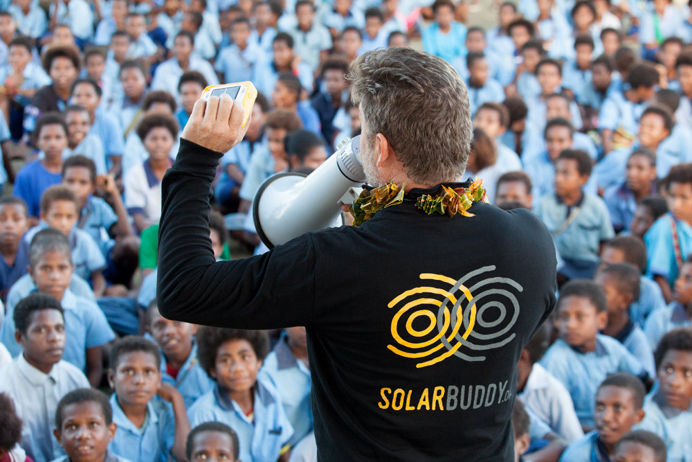 CEO, Simon Doble talking to students in PNG about how the SolarBuddy lights work, their features and how to take care of them.