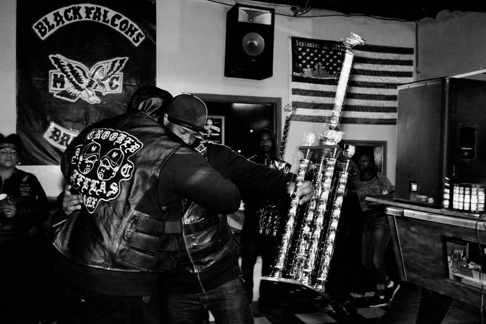 Choice awards a trophy to Crooked Fellas AC (automotive club) at the Black Falcons MC trophy party, The Bronx, 2016